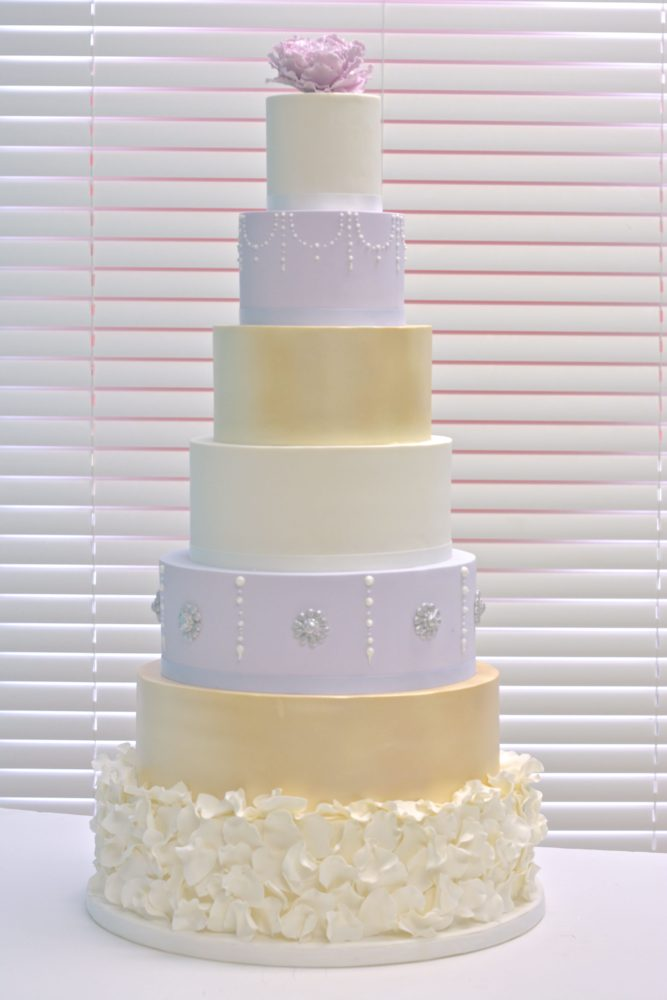 7 tier gold, ivory and lilac wedding cake
