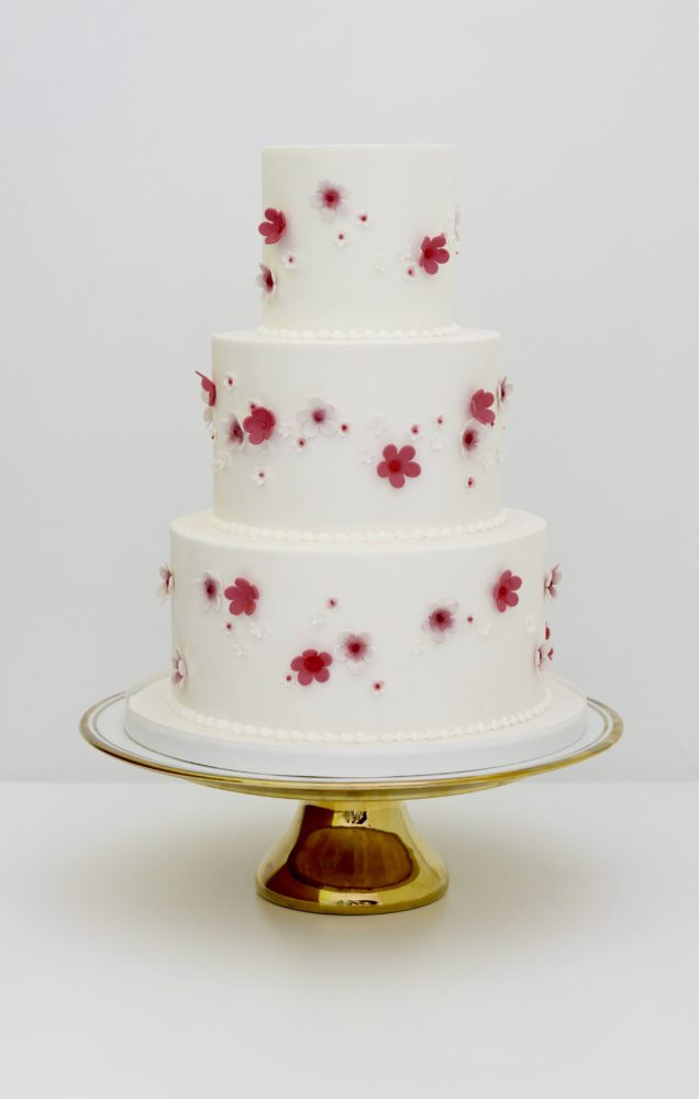 3 tier cake with pink sugar blossoms
